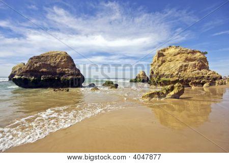 Natural rocks near Alvor at Praia Tres Irmaos in Portugal