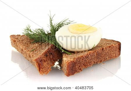 Boiled egg  on dark bread isolated on white