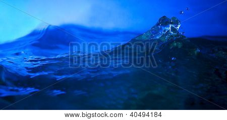 splashing water in deep blue background