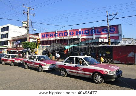 Mexican Market And Taxis