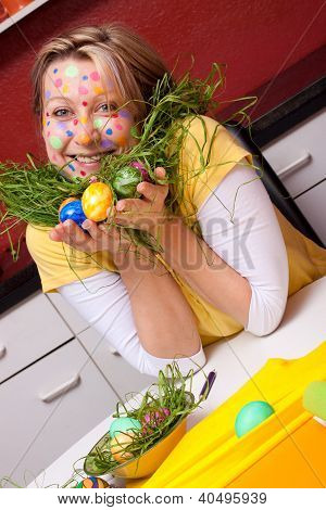 Girl With Easter Eggs And Grass Around Her Neck