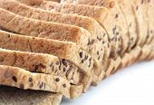 Closeup Of Multigrain Bread Slices With Flaxseeds And Pumpkin Seeds On White Background