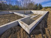 stock photo of foundation  - Concrete foundation for a new house ready for pouring basement slab - JPG