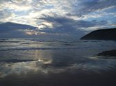 Watery Sunset over Sandy Beach poster