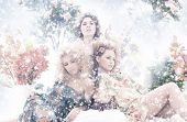 Fashion shoot of young beautiful nymphs in the abstract winter forest
