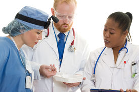 pic of health-care  - doctors, specialists and surgeon in discussion. focus on man - JPG