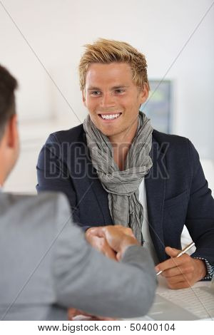 Young man meeting banker for financial project