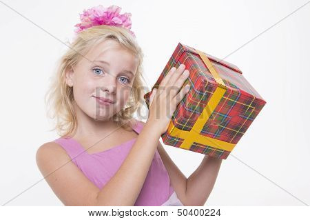 Girl is eager to open a gift