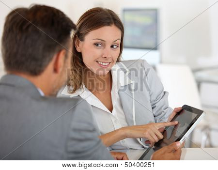 Young woman presenting business plan to financial investor