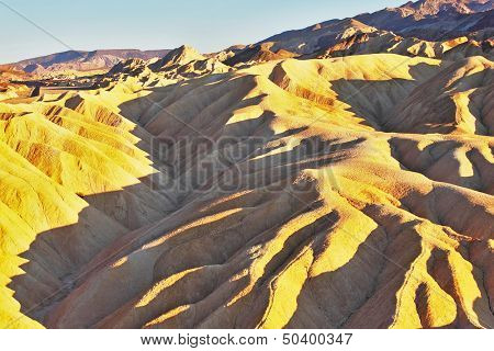 Pink sunset in Death Valley. Soft sand waves of the famous Zabriskie - Point
