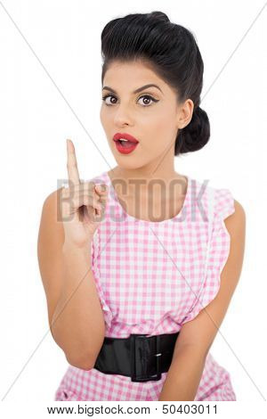 Astonished black hair model looking at camera on white background