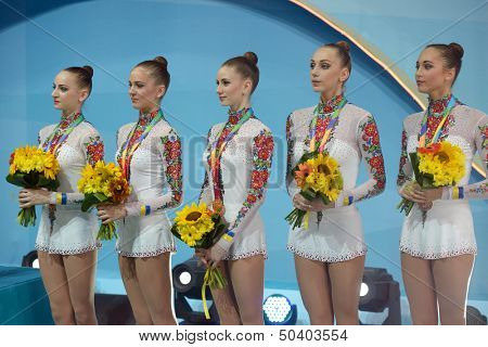 KIEV, UKRAINE - SEPTEMBER 1: Team Ukraine win bronze in the routing with clubs during the 32nd Rhythmic Gymnastics World Championships in Kiev, Ukraine on September 1, 2013