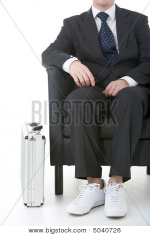 Businessman Sitting Wearing Sneakers