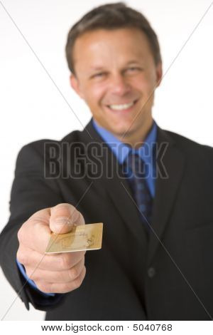 Businessman Handing Over Gold Credit Card