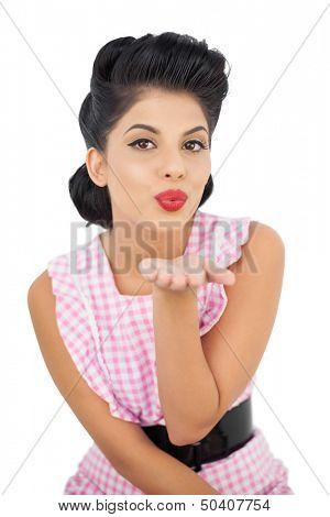 Pretty black hair model blowing a kiss to the camera on white background