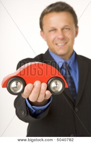 Businessman Holding A Toy Car