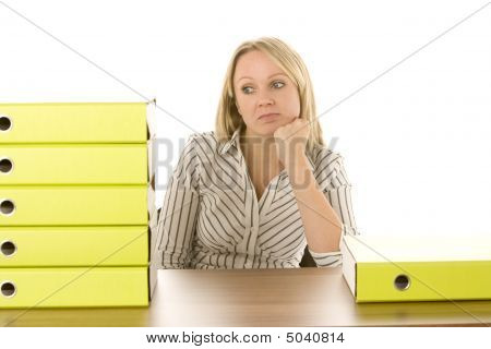 Businesswoman With Stack Of Folders