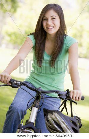 Teenage Girl On Bicycle