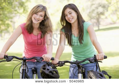 Teenage Girls On Bicycles