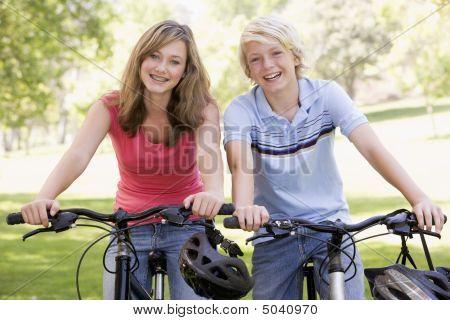 Teenage Boy And Girl On Bicycles