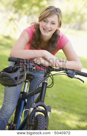 Teenage Girl On Bicycle