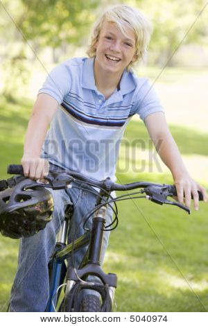 Teenage Boy On Bicycle