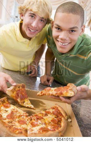 Teenage Boys Eating Pizza