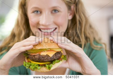 Teenage Girl Eating Burgers