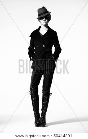 Luxury Fashion model, a beautiful woman posing in studio on white background. Black and white photo.
