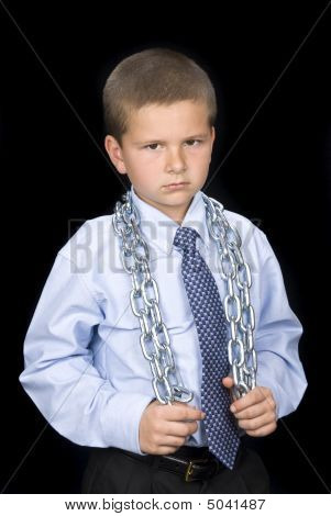 Boy With Suite And Chain Around Shoulders