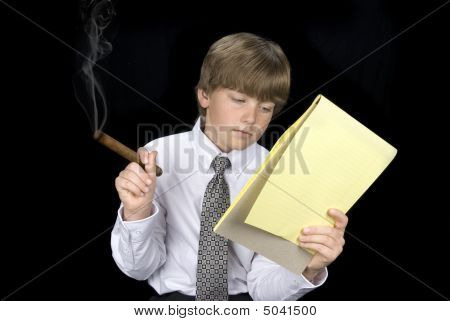 Boy In Business Suit Smoking Cigar And Reading