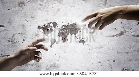 Close up of human hands touching with fingers. Based on Michelangelo picture. Elements of this image are furnished by NASA