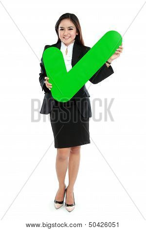 Full Lenght Of Businesswoman Holding Check Mark Sign