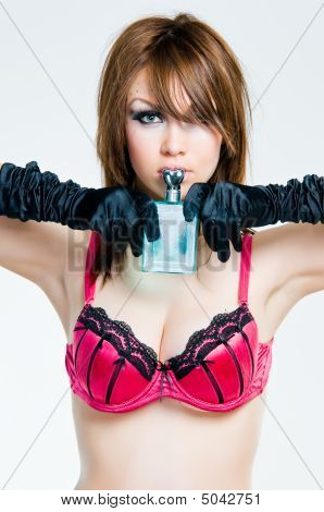 Portrait Of Pin-up Girl With Perfume Bottle