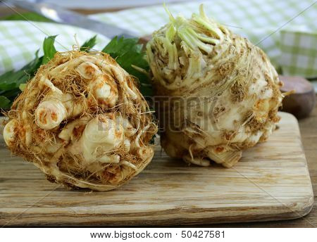 fresh organic celery root with green leaves