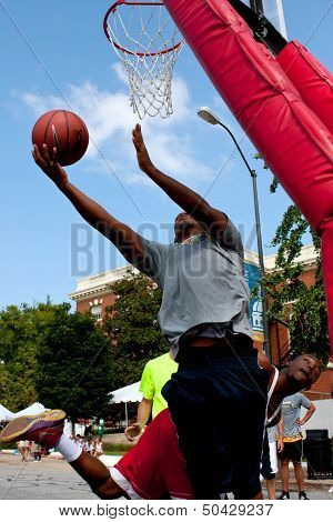 Man Shoots Reverse Layup In Outdoor Street Basketball Tournament
