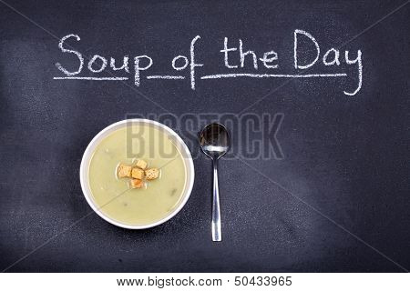 Chalkboard advertising the soup of the day, with a bowl of leek and potato soup and spoon, garnished with bread croutons, and space for your text