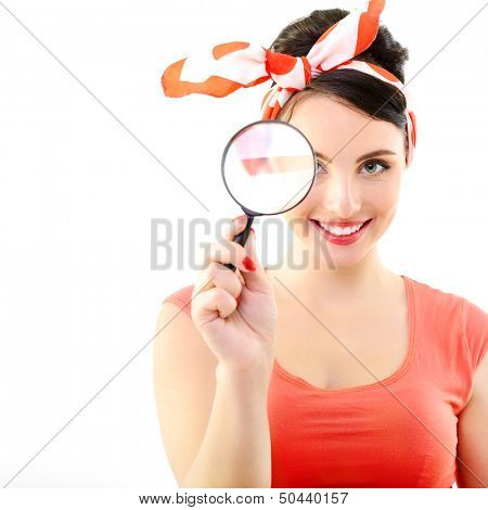 Pinup girl with magnifying glass, portrait of young happy sexy woman in pin-up style, over white