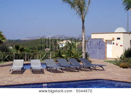 Chairs. Swimming Pool. Loungers
