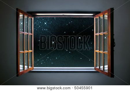 Room window wide open to a calm and clear starry night sky