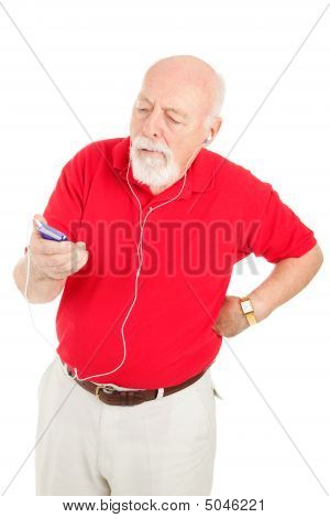 Senior Man Annoyed By Mp3 Player