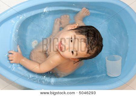 Cute Baby Girl Enjoying Her Bath