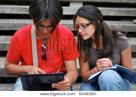 Attractive Hispanic Couple Using A Computer Together