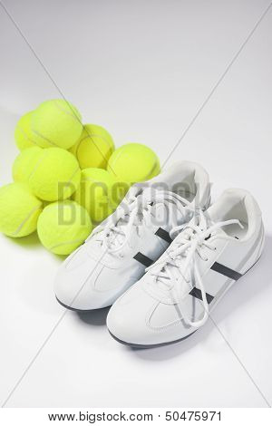 Tennis Concepts: Tennis Trainers And Tennis Balls Together