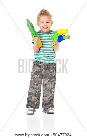 Happy boy with plastic water guns isolated on white background