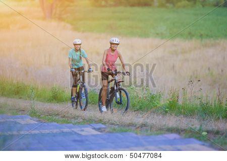 Portrait Of Two Nice Sportswomen Having Journey Outside