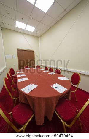Modern empty conference room with a red carpet on the floor