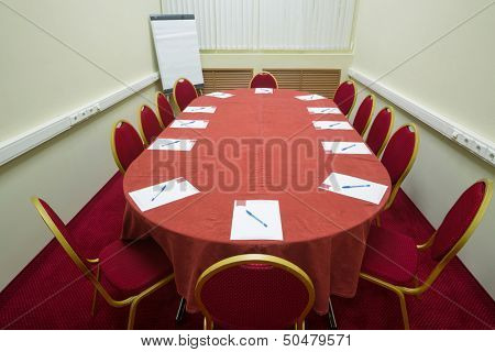 Empty conference room with a red carpet on the floor