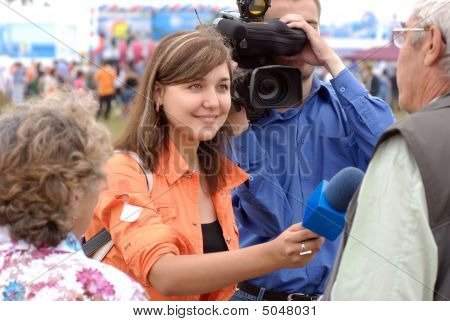 Smiling Female Tv Reporter