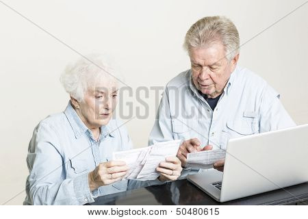 Senior couple is concerned with bills